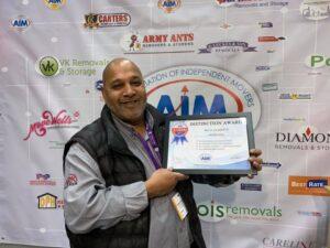 Gabby Receiving award